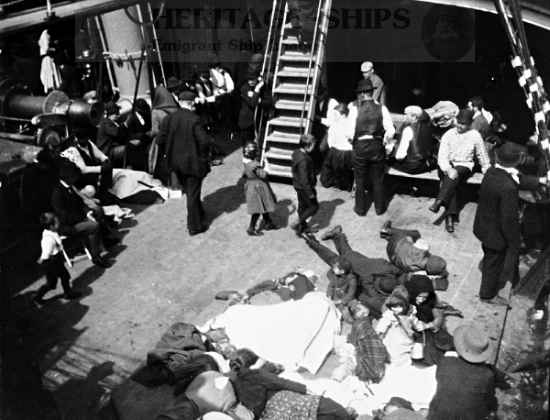 This ship sailed between Bremen and New York via Southampton and Cherbourg. The picture shows steerage passengers gathered on the deck of the steamship. Some are lying straight out on the deck as if they are sea-sick, which was often a peril for many emigrants. This image is in memory of all those who suffered on the voyage across the ocean.